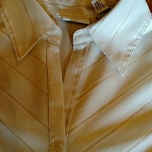 Beautifully tailored striped button down shirt.